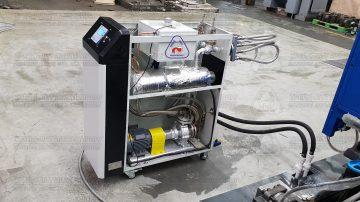 Термостат со снятыми крышками, в процессе опрессовки перед запуском в эксплуатацию в составе автоматизированного комплекса литья под давлением MS160