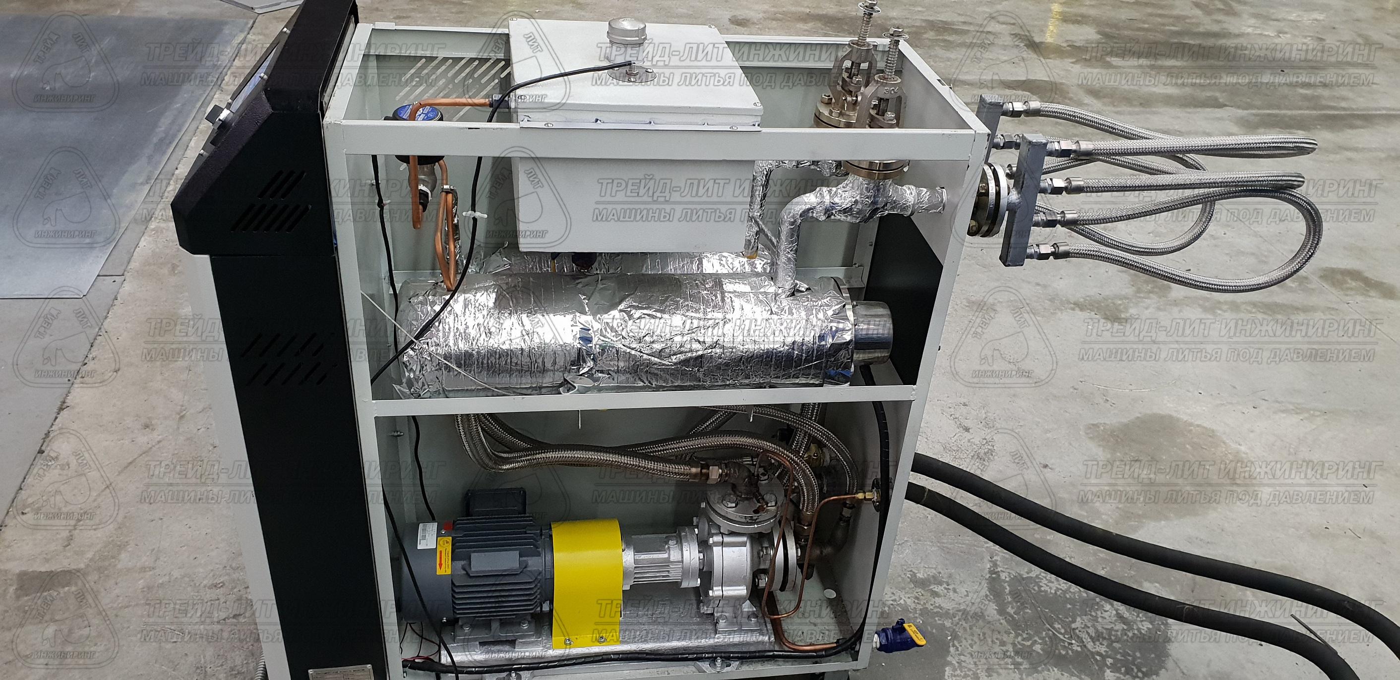 Термостат со снятыми крышками, в процессе опрессовки перед вводом в эксплуатацию в составе автоматизированного комплекса литья под давлением MS160