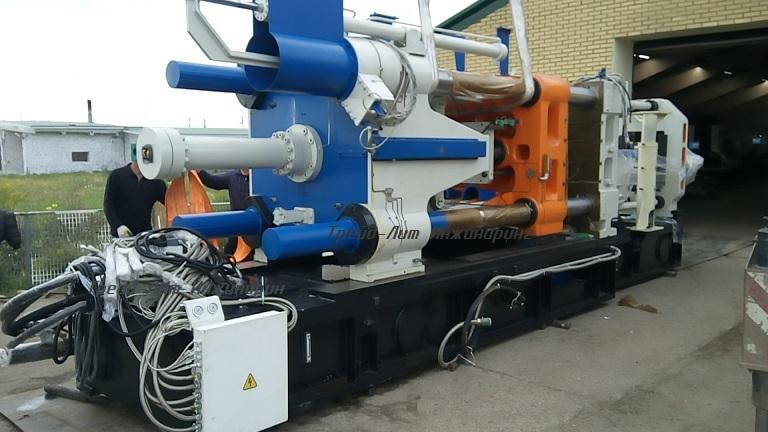 Выгрузка и предварительная сборка перед транспортировкой к месту установки, автоматизированного комплекса литья под давлением MS900, на базе машины литья под давлением с усилием запирания 900 тонн