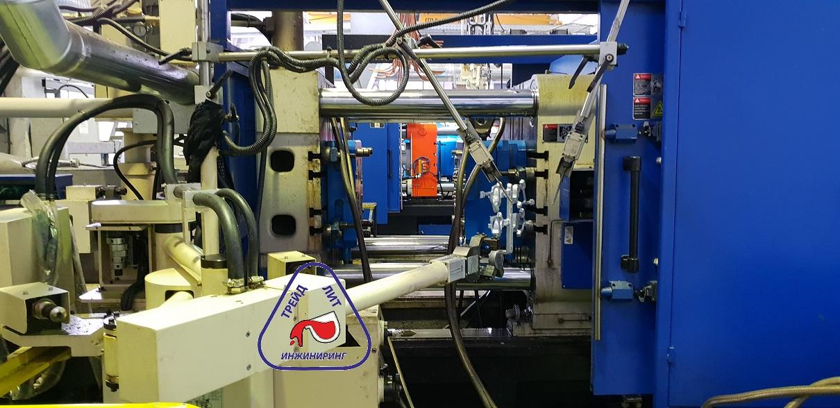 Автоматический съем четырех-местоного куста отливок